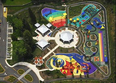 "The Clemyjontri Park playground fills a 2 acre site in Fairfax VA, and features four outdoor ""rooms"" surrounding a central carousel"