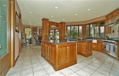 Kitchen features heated floor, and 2 Islands, as well as breakfast bar and pass thru to informal dining area.